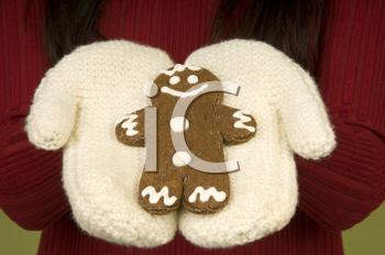 Royalty Free Photo of Gingerbread in Mittened Hands
