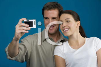 Royalty Free Photo of a Couple Taking a Self Portrait