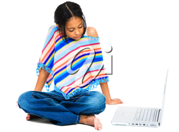 Latin American and Hispanic girl sitting near a laptop isolated over white