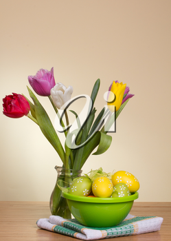 Easter eggs and fresh spring flowers