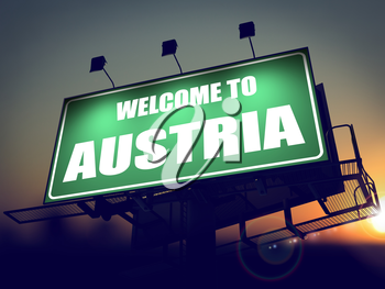 Welcome to Austria - Green Billboard on the Rising Sun Background.