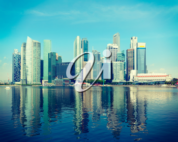 Vintage retro hipster style travel image of Singapore skyline of business district and Marina Bay in day