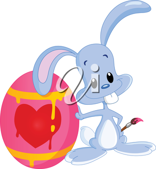 Cute bunny lying on his painted Easter egg holding a paintbrush