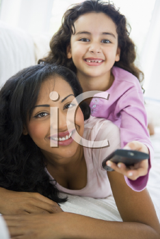 Royalty Free Photo of a Mother and Daughter With a Remote