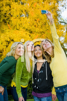 Royalty Free Photo of Four Woman Taking a Self Portrait