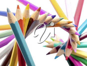 Spiral of colored pencils isolated on white background