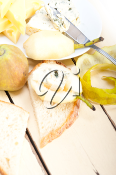selection of different cheese and fresh pears appetizer snack